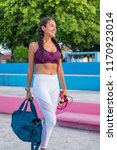 latin woman ready for the gym | Shutterstock . vector #1170923014