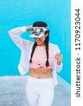 latin woman on trendy sportswear | Shutterstock . vector #1170923044