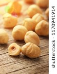 hazelnuts on wooden table | Shutterstock . vector #1170941914
