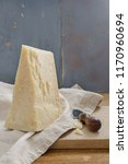 parmesan cheese on wooden table ... | Shutterstock . vector #1170960694