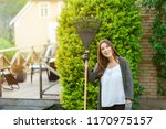 smiling young woman with garden ... | Shutterstock . vector #1170975157