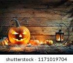 halloween pumpkins in rustic... | Shutterstock . vector #1171019704