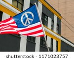 Stock photo an american flag designed with a peace symbol flies during the march for our lives protests in 1171023757