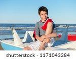young boy sitting on catamaran... | Shutterstock . vector #1171043284