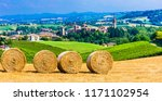 scenic countryside with hay... | Shutterstock . vector #1171102954