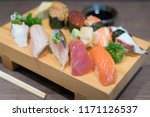 close up sushi and sashimi... | Shutterstock . vector #1171126537