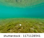 underwater view of crystal... | Shutterstock . vector #1171128541