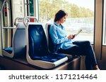 hipster girl sitting in tram... | Shutterstock . vector #1171214464