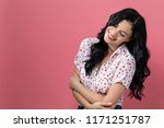 happy young woman on a solid... | Shutterstock . vector #1171251787