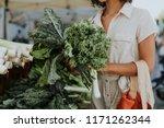 Beautiful Woman Buying Kale At...