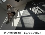 model sits on the floor in a... | Shutterstock . vector #1171364824
