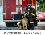 Photo Of Fireman Squatting Nex...
