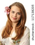 Beautiful woman in a bathrobe with a orchid in her hair - stock photo