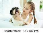 portrait of happy girl holding... | Shutterstock . vector #117139195