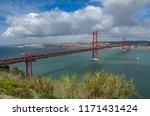 the 25 de abril bridge and... | Shutterstock . vector #1171431424