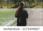 photo from the back of a girl... | Shutterstock . vector #1171434067