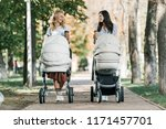 mothers walking with baby... | Shutterstock . vector #1171457701