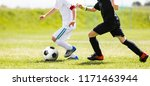 children kicking soccer ball.... | Shutterstock . vector #1171463944
