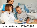 dentist and his assistant in... | Shutterstock . vector #1171465987