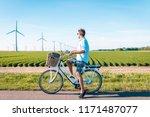 young man electric green bike... | Shutterstock . vector #1171487077