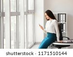 young businesswoman with mobile ... | Shutterstock . vector #1171510144