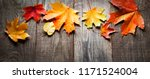 autumn leaf on wood black... | Shutterstock . vector #1171524004