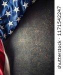 American Flag On Dark Concrete...