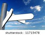 Blank signpost against blue sky - stock photo