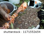 the human hand pushes shish...   Shutterstock . vector #1171552654