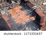 grill grill with meat  cooked...   Shutterstock . vector #1171552657