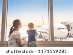 mother and son at airport... | Shutterstock . vector #1171559281