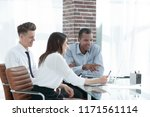 employees talking to a customer ... | Shutterstock . vector #1171561114