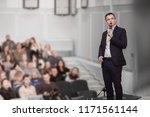 speaker conducts the business... | Shutterstock . vector #1171561144