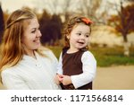 young mother and her cute... | Shutterstock . vector #1171566814