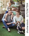 happy family and pet dog on the ... | Shutterstock . vector #1171567504