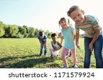 cute little children outdoors... | Shutterstock . vector #1171579924
