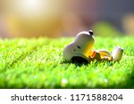 Small photo of Songkhla, Thailand - September 3, 2018: Snoopy and Charlie Brown plastic toys Standing looking at a green meadow.
