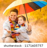 a little boy and his father are ...   Shutterstock . vector #1171605757