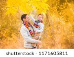 a little boy in the arms of his ...   Shutterstock . vector #1171605811