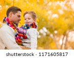 a little boy in the arms of his ...   Shutterstock . vector #1171605817