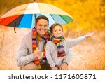 a little boy and his father are ...   Shutterstock . vector #1171605871