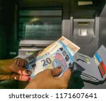 young woman withdrawals euro... | Shutterstock . vector #1171607641