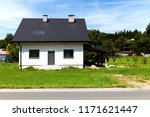 a newly built family home with... | Shutterstock . vector #1171621447