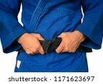 judo. black belt. blue kimono.... | Shutterstock . vector #1171623697