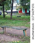 bench in the courtyard of the... | Shutterstock . vector #1171629151