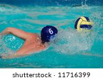 Water polo player swimming for the ball - stock photo