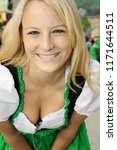 young blond woman in dirndl... | Shutterstock . vector #1171644511