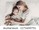 young mother and little... | Shutterstock . vector #1171650751