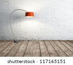 floor lamp in brick room - stock photo
