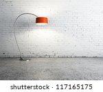 floor lamp in white brick room - stock photo